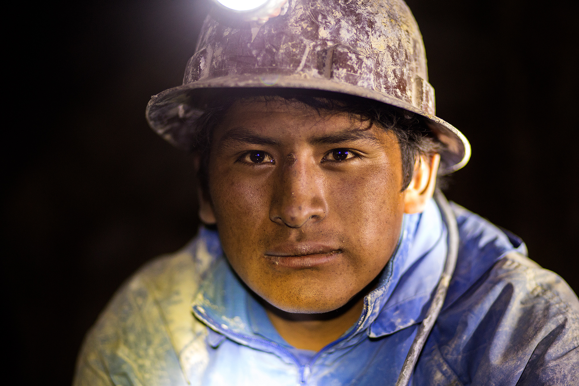 Booked a tour to the silver mines of Potosí, Bolivia. The working conditions are cruel and it was an impressive experience to visit local people there. I asked for permit to use the photo but there is no contract signed nor do I have the contact of that man.